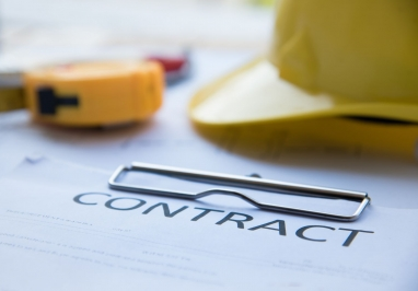 Image of construction contract and hard hat